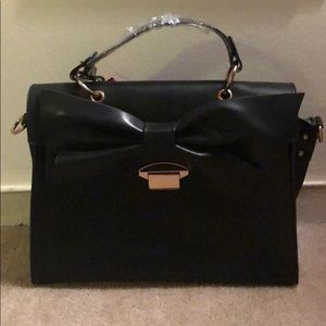 Bags - Never worn. Black hand bag with bow detail